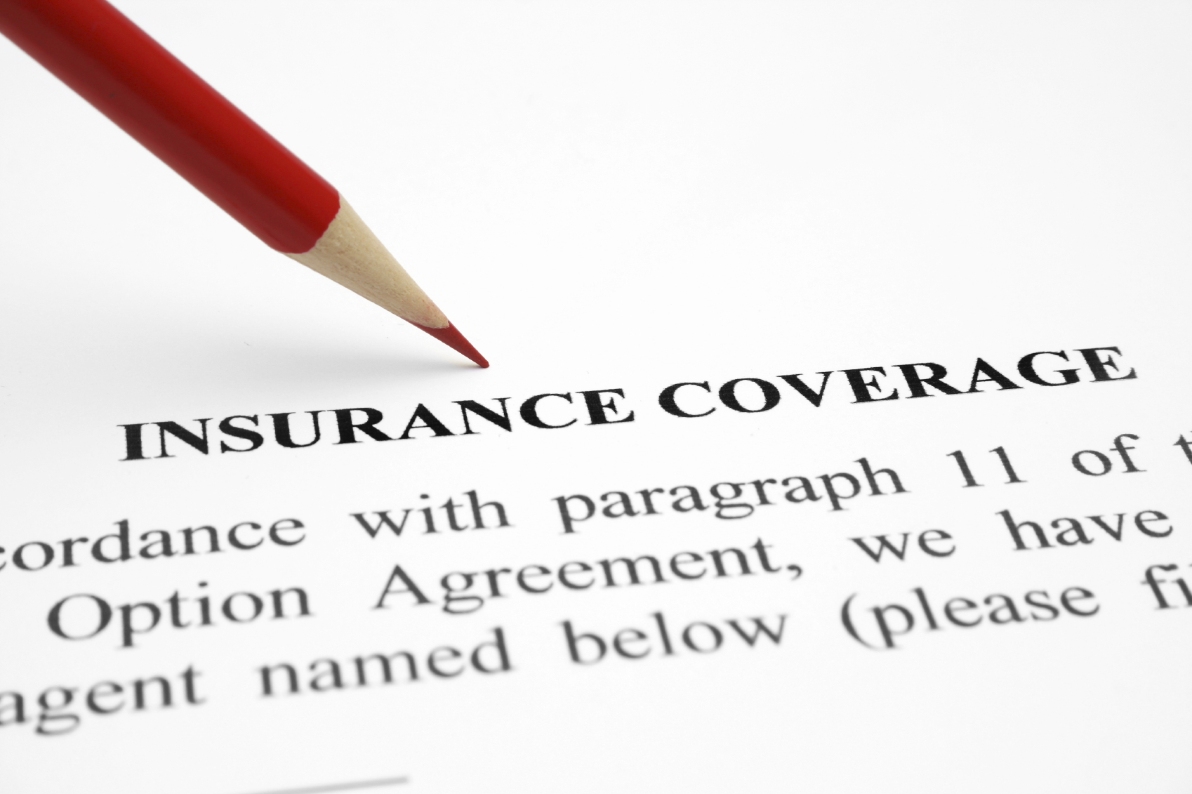 """Pencil pointing to paper that reads """"Insurance Coverage"""""""