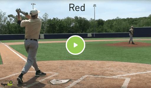 Man swinging baseball bat on baseball field with another man